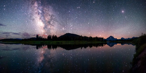 The Milky Way reflected in the Snake River at the famous Oxbow Bend in Grand Teton National Park.